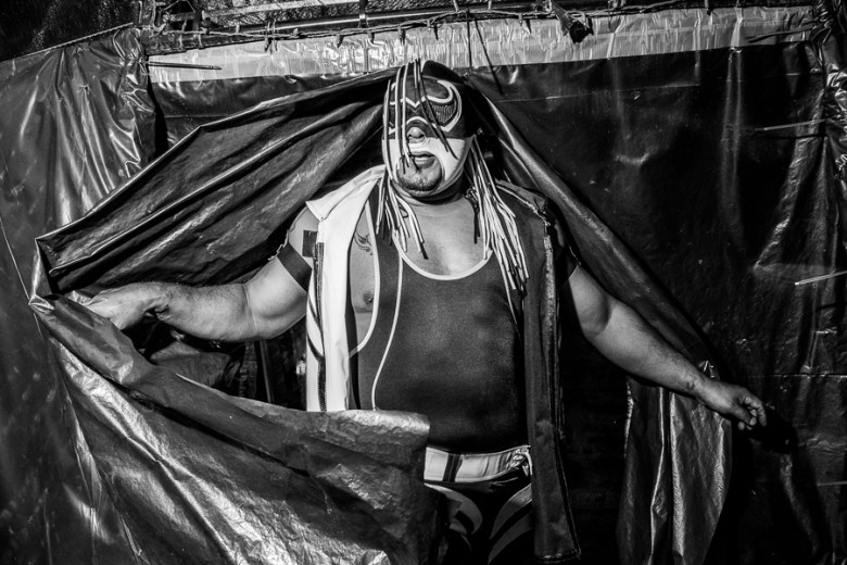 A luchador emerges from the dressing room. Photo by Scott Ball.