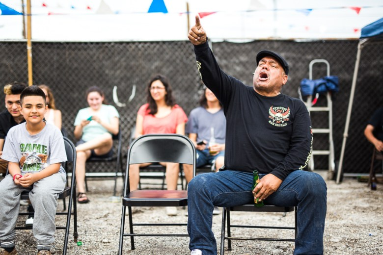 A man shouts at a luchador. Photo by Scott Ball.