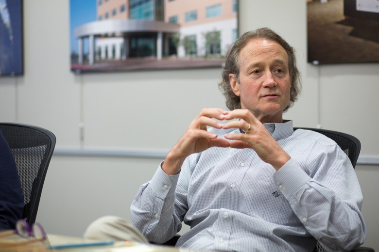 CEO of Metropolitan Contracting Company, LLC Tim Swan talks with The Rivard Report during a meeting. Photo by Scott Ball.