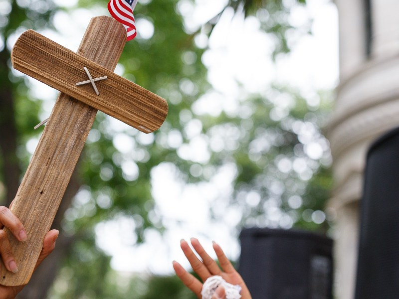 A cross held during the National Day of Prayer at City Hall on Thursday. Photo by Scott Ball.