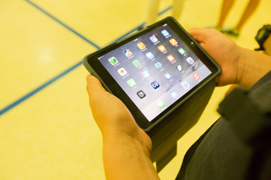 A student uses a grant purchased iPad at Whittier Middle School. Photo by Scott Ball.