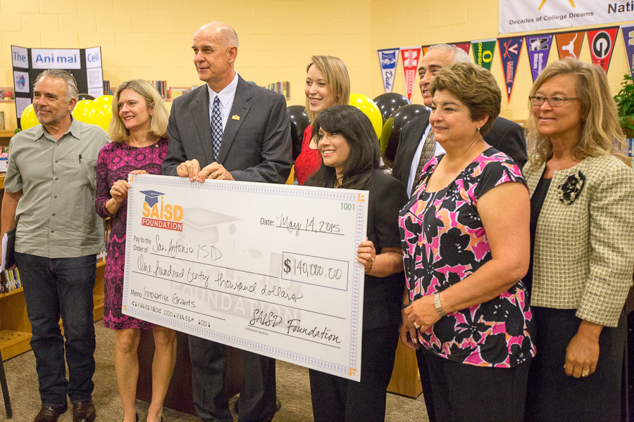 An SAISD Foundation check for innovative grants is presented at Whittier Middle School. Photo by Scott Ball.