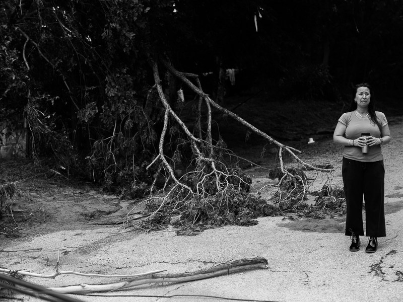 Wimberley resident Colette Resnikoff sees the devastation for the first time. Photo by Scott Ball.