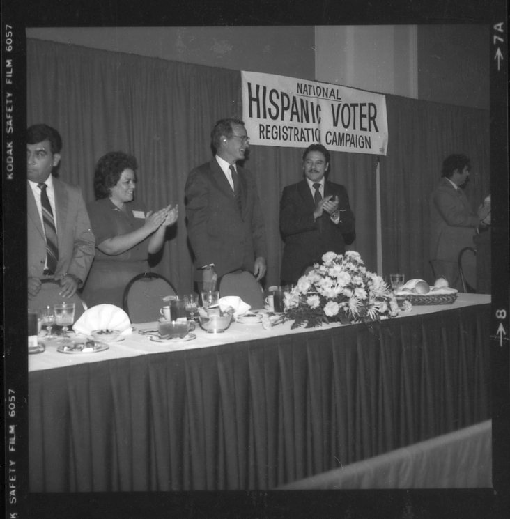 Willie Velasquez and President George H.W. Bush attend an hispanic voter registration campaign event. Photo courtesy of UTSA Libraries Special Collection.