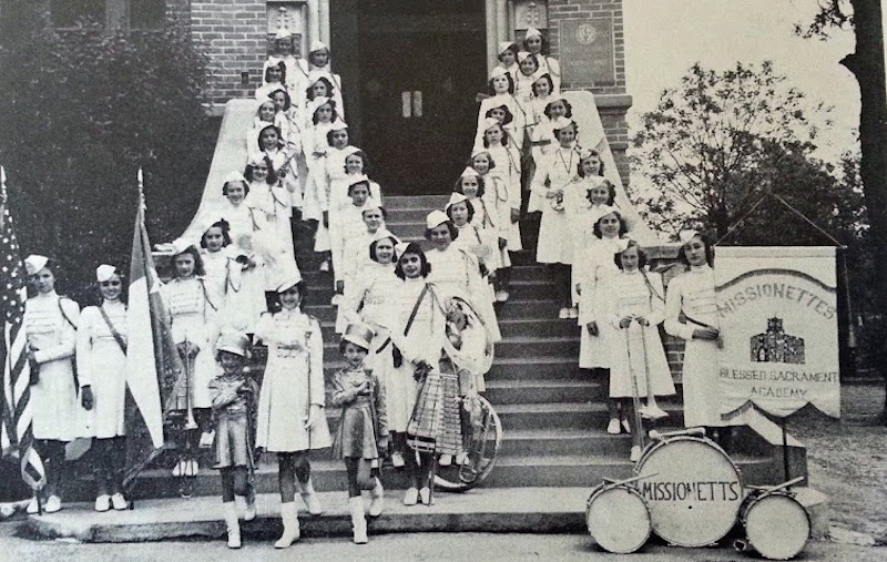 The Missionettes pose for a photo in front of the Blessed Sacrament Academy convent building in 1940. Historic photo.
