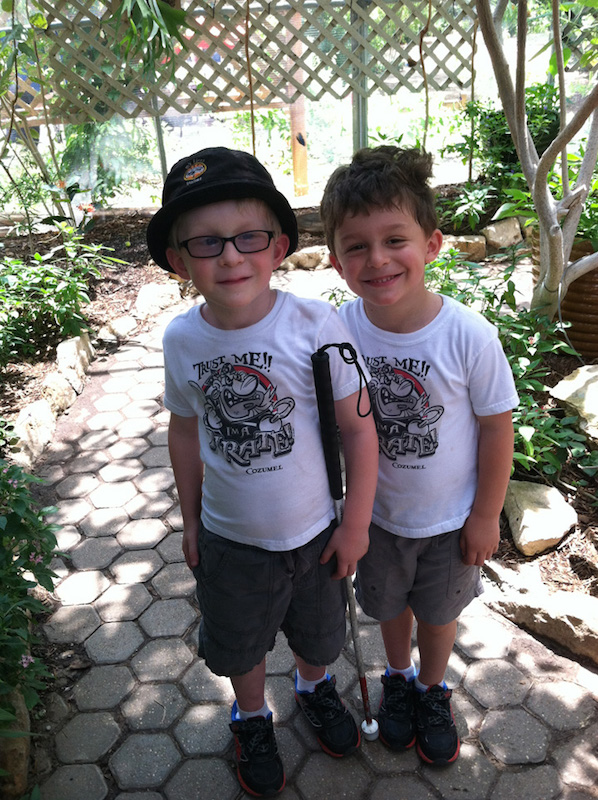 Danny, shown with his fraternal twin, Marty, was born with Albinism and has little or no pigment in his eyes, skin and hair. Photo courtesy of San Antonio Lighthouse for the Blind.