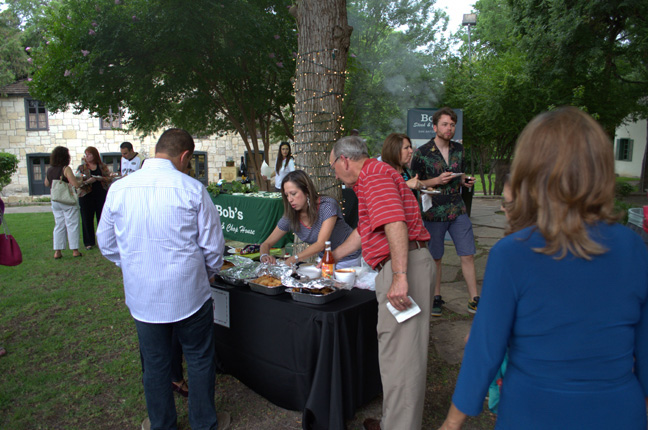 Guests enjoy food from several restaurants at The Witte Museum during a previous Art in the Dark event. Photo courtesy of San Antonio Lighthouse for the Blind.
