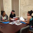 Emily Lamas, Alexus Rodriguez, and Chassidy Alcorta analyze the pyramid of hate. Photo by Tamara Sager.