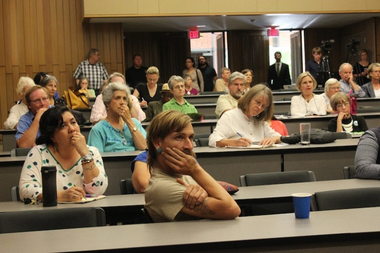 Audience members listen intently to the mayoral candidates. Photo by Lea Thompson.