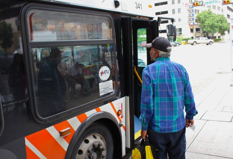 A passenger enters onto a Via Bus. Photo by Hagen Meyer.
