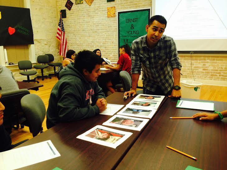 James Juarez helps Michael Trevino analyze examples of prejudice and discrimination. Photo by Tamara Sager.