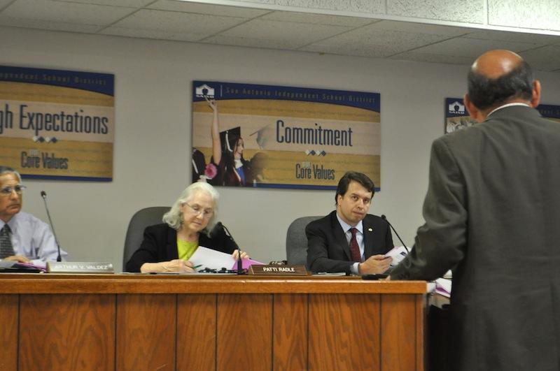 From left: Trustee Arthur Valdez (D4), Board President Patti Radle (D5), and Superintendent Pedro Martinez listen to SAISD CFO Larry Garza's presentation. Photo by Iris Dimmick.