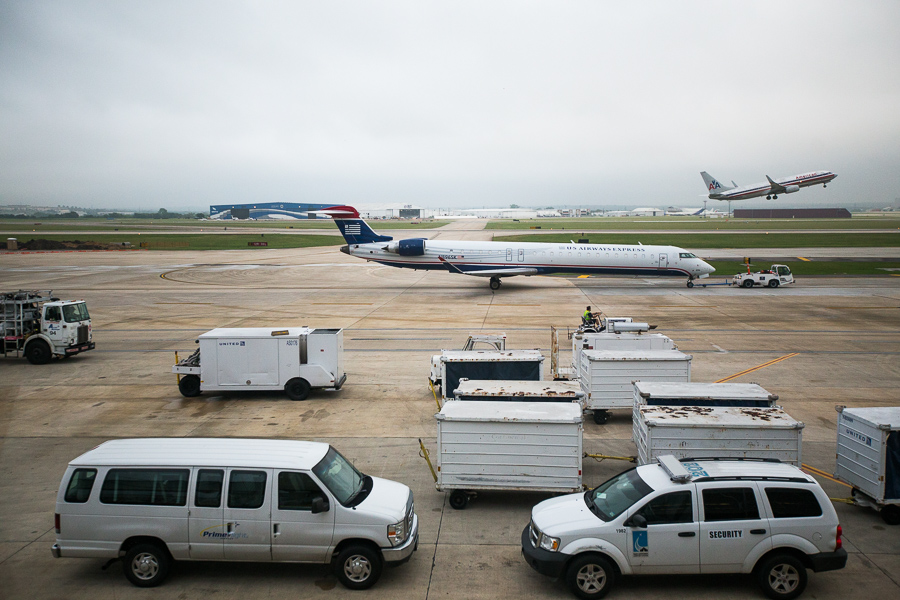 Planes take off and are towed on the runway. Photo by Scott Ball.