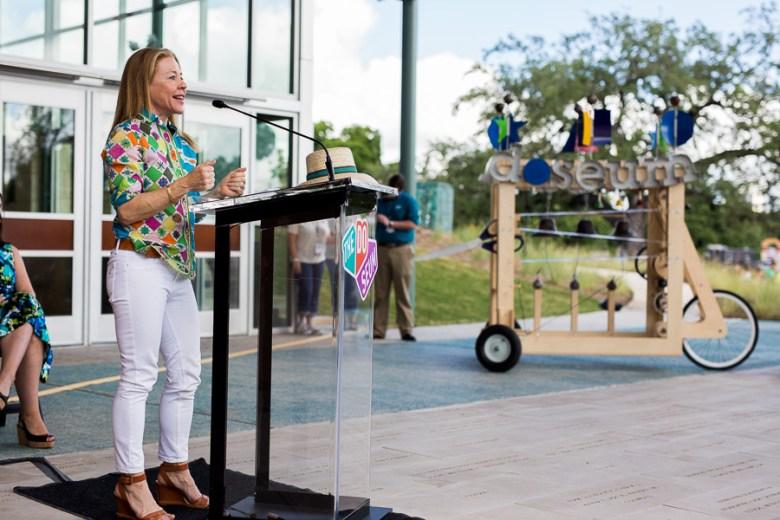 Board chair Joan Collins Wyatt addresses the crowd. Photo by Scott Ball.