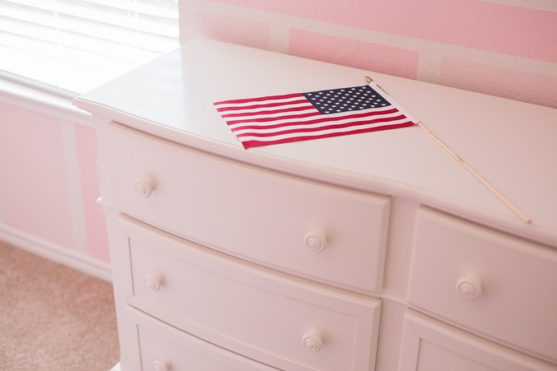 An American flag lays on a dresser in Tara Ranges new bedroom. Photo by Scott Ball.
