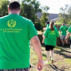 Volunteers walk toward stacks of sod for transport. Photo by Scott Ball.