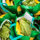 Bags of fresh produce await donation. Photo by Scott Ball.