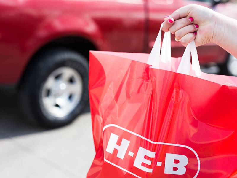 An H-E-B bag filled with produce. Photo by Scott Ball.