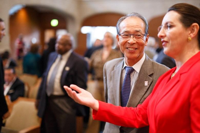 Head of International Relations, Sherry Dowlatshahi (right) speaks with Yasuo Saito. Photo by Scott Ball.