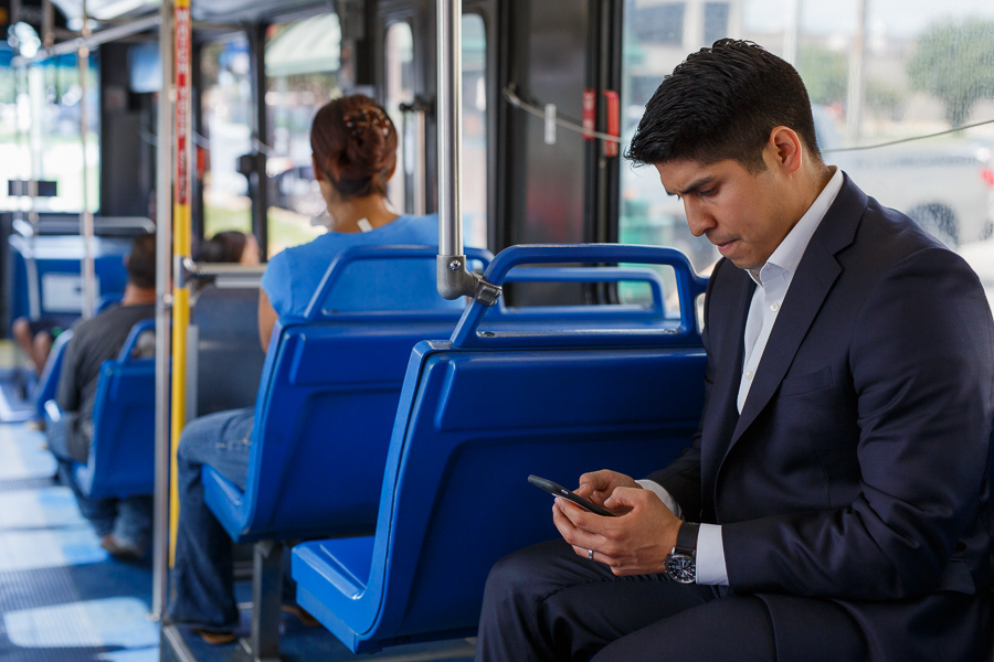 Councilman Rey Saldaña checks his phone trying to locate the route he is currently on. Photo by Scott Ball.