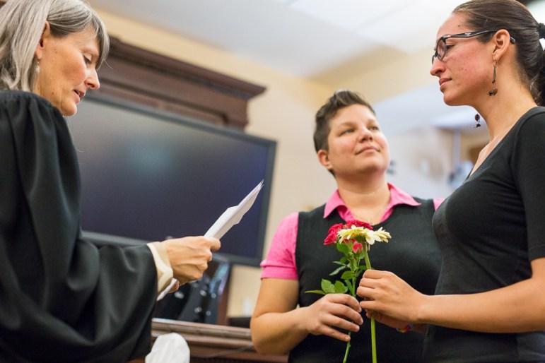 Judge Karen Pozza weds Tiana Rei Lucas and Kelly Anne Motley. Photo by Scott Ball.