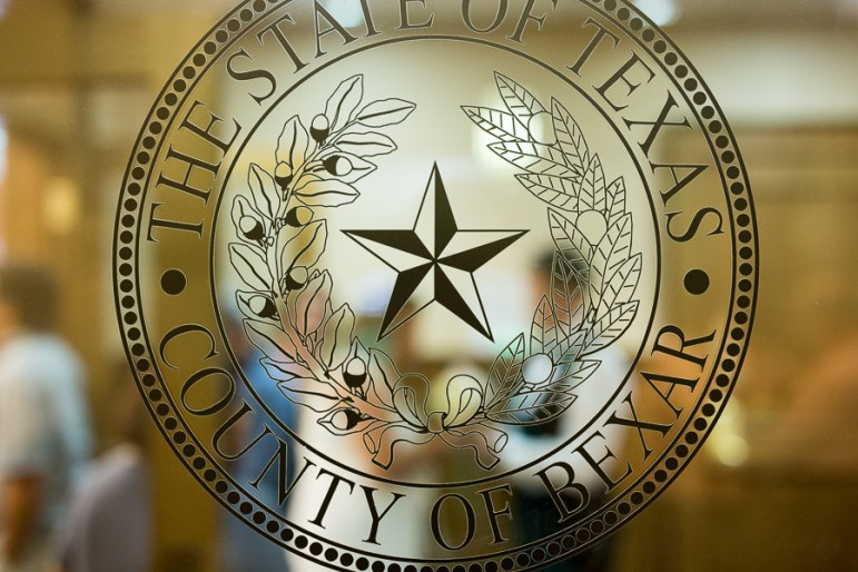 The Bexar County Texas seal glazed onto the entrance of the courtroom in which marriages were being performed. Photo by Scott Ball.