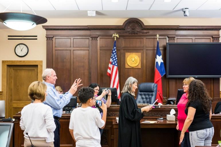 Judge Karen Pozza weds Norma De La Cruz and Juanita De La Cruz as family and friends look on. Photo by Scott Ball.