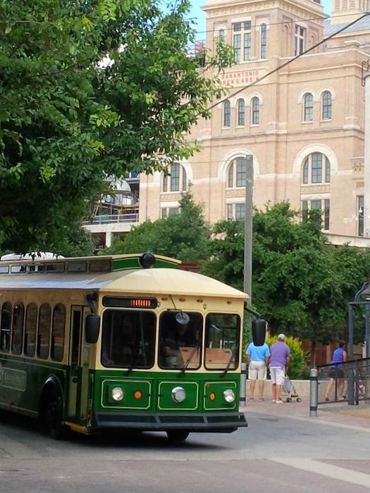 The GreenStreet trolley rolls by the Pearl Brewery. Photo courtesy of Hometown Trolley.
