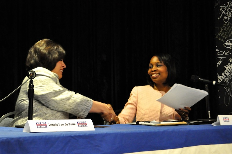 Leticia Van de Putte and Mayor Ivy Taylor shake hands after the debate. Photo by Iris Dimmick.