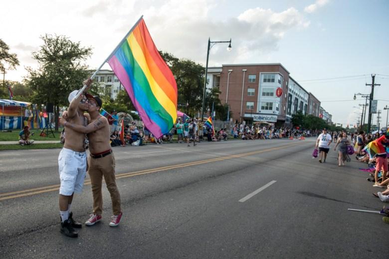 Andy Jo Lopez kisses Eriq Chatman in the street.  Photo by Matthew Busch.