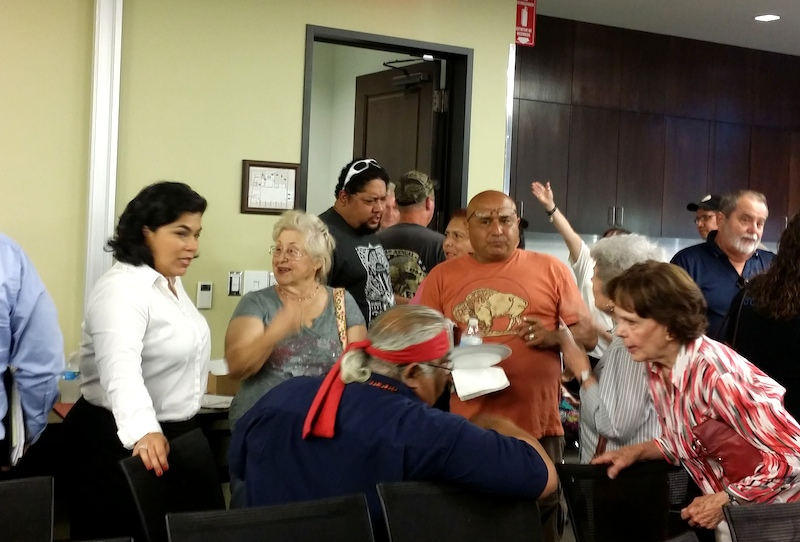 Councilwoman Rebecca Viagran (D3) speaks with residents after the community meeting. Photo by Iris Dimmick.