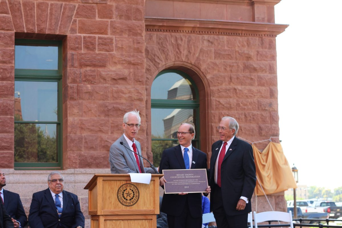 Bexar County Judge Nelson Wolff received a plaque from Texas Historical Commission Chair John Nau and Executive Director Mark Wolfe in recognition of the rededication of the Bexar County Courthouse. Photo by Joan Vinson.