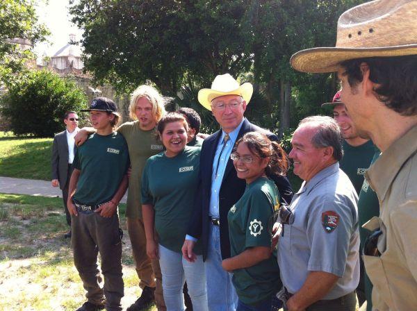 Interior sEcretary Ken Salazar poses with volunteers at Mission Concepción in 2012. Photo by Robert Rivard