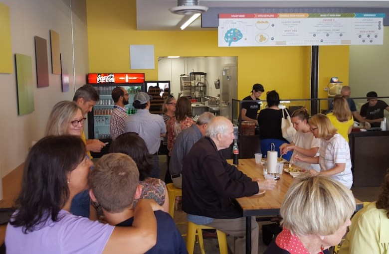 A crowd of people at Moshe's Golden Falafel. Photo by Winslow Swart.