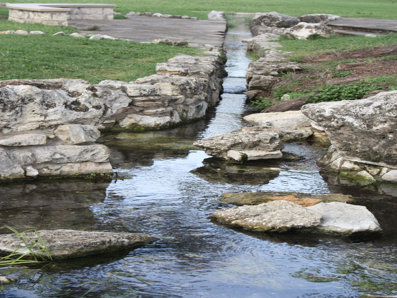 A babbling brook flows just west of the swimming pool. Photo by Kay Richter.