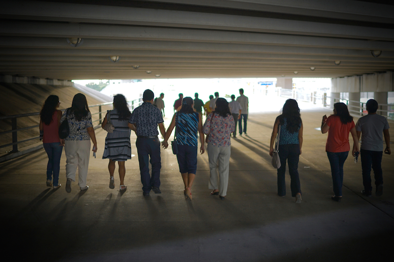 Attendees of the 60th General Conference Session of the Seventh-day Adventist Church walk back downtown from the Alamodome on the new pedestrian bridge. Photo by Joe Van Wyk.