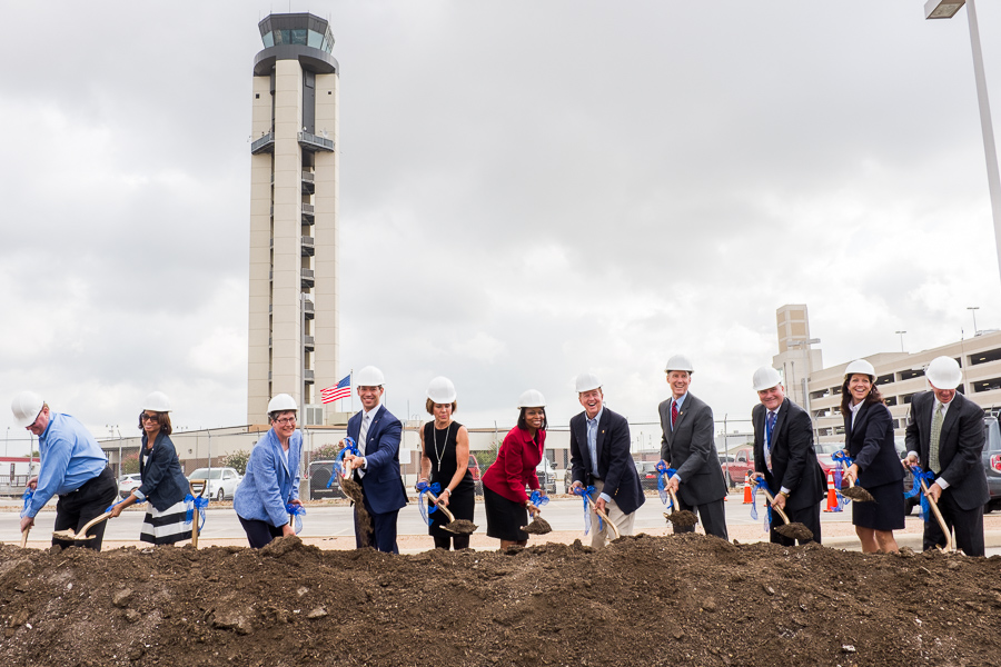 City officials and San Antonio International Airport employees officially break ground by shoveling dirt. Photo by Scott Ball.