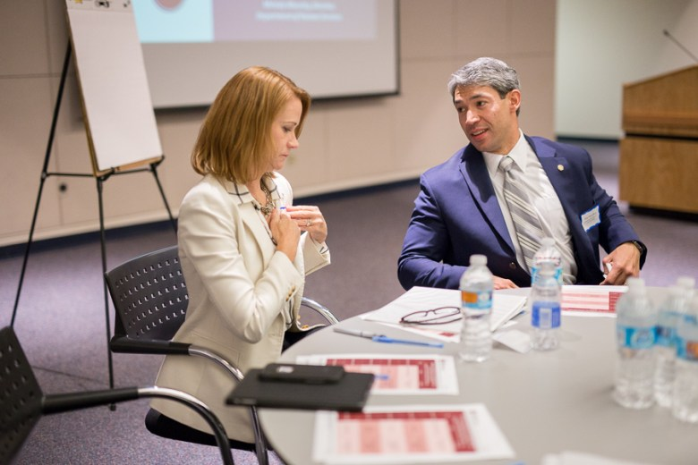 Melody Woosley, director of the City's Department of Human Services speaks with Councilmember Ron Nirenberg (D8). Photo by Scott Ball.