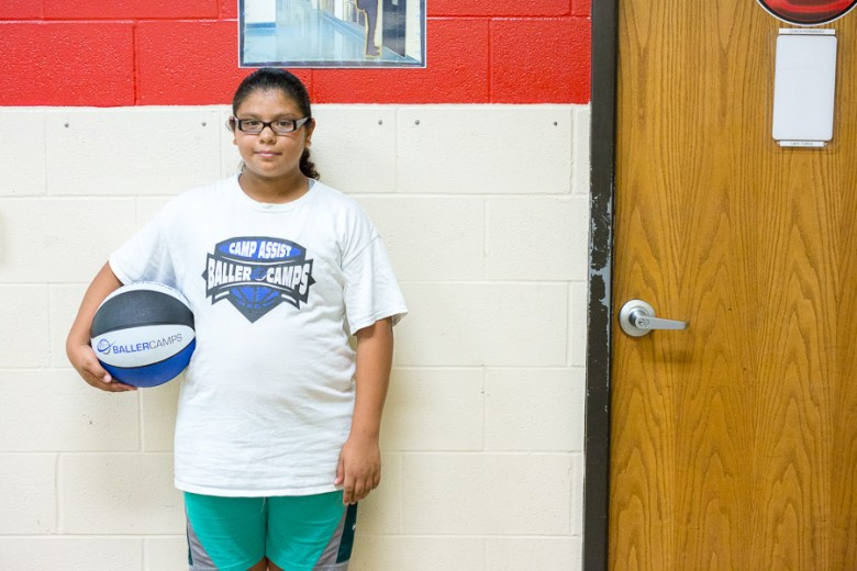 Ashlyn Lopez, 11, is entering 7th grade, but the coaches brought her and a few others back to help lead the new campers. It is also an opportunity for her to prepare for her first year of athletic eligibility. Photo by Scott Ball.