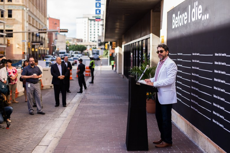Councilmember Roberto Treviño speaks at unveiling of the Before I die... public art display. Photo by Scott Ball.