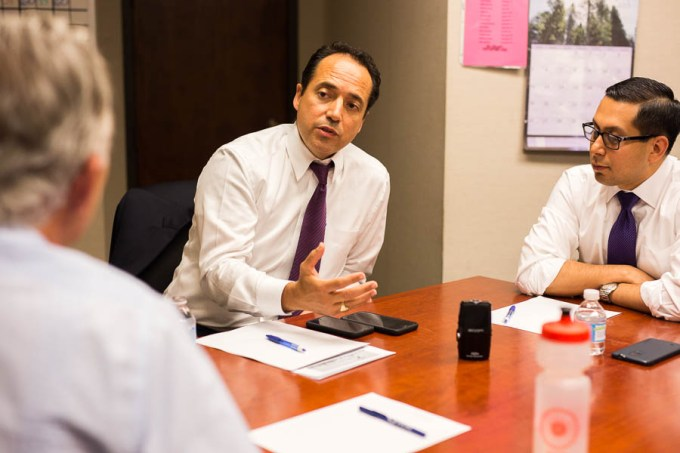 Senator José Menéndez (middle) speaks with State Representative Dist. 123 Diego Bernal (right) and Robert Rivard (left) during a podcast recording. Photo by Scott Ball.