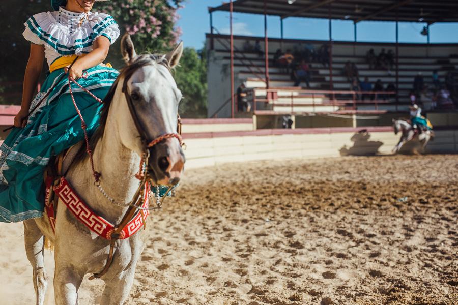 Escaramuzas ride circles around the ring. Photo by Scott Ball.