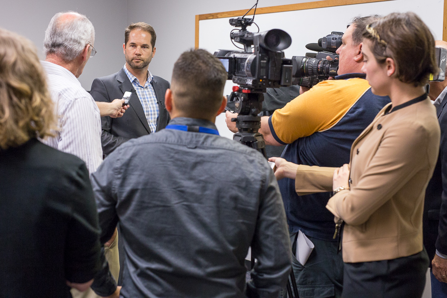Jeff Coyle, the City's intergovernmental relations director, speaks with media before the July 10 contract negotiations begin. Photo by Scott Ball.