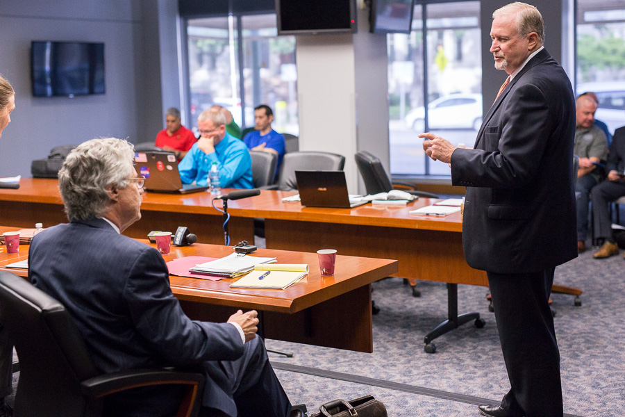 Jeff Londa (left), who leads the City's team, speaks with attorney Ron DeLord, the police union team's lead negotiator. Photo by Scott Ball.
