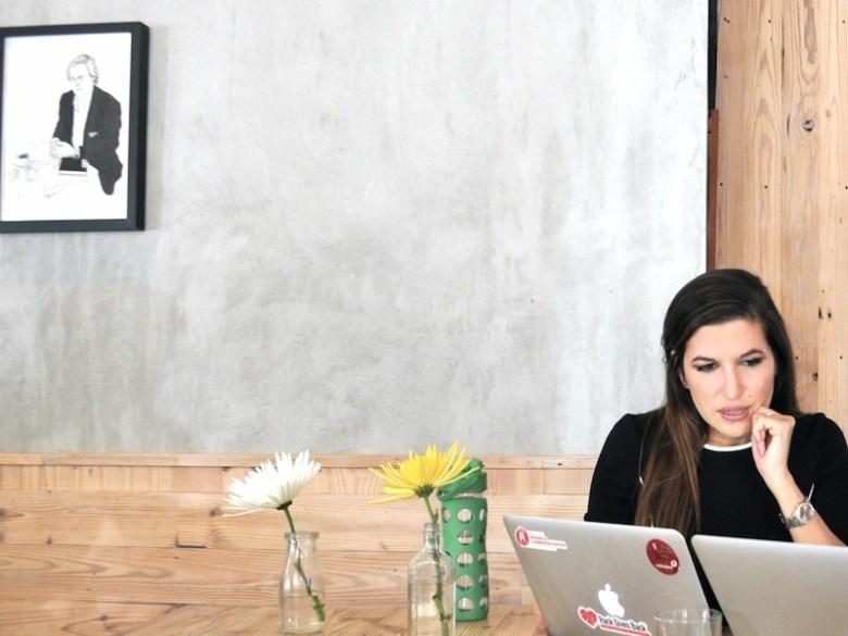 TechBloc Executive Director Marina Gavito hard at work during a meeting at Bakery Lorraine. Photo by Iris Dimmick.