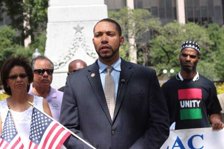 Commissioner Tommy Calvert led the protest on Saturday morning. Photo by Joan Vinson.
