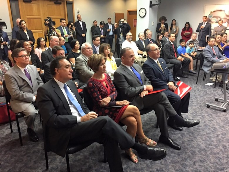 Business, community leaders, and local media gather for the Business Connect launch at City Hall. Front row from left: Former mayor Henry Cisneros, City Manager Sheryl Sculley, SAHCC Board Chair Al Aguilar, and SAHCCPresident and CEO Ramiro Cavazos. Photo courtesy of SAHCC's Facebook page.