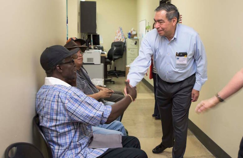(Retired) General Ricardo Sanchez greets homeless veteran dental patients. Photo by Paola Longoria