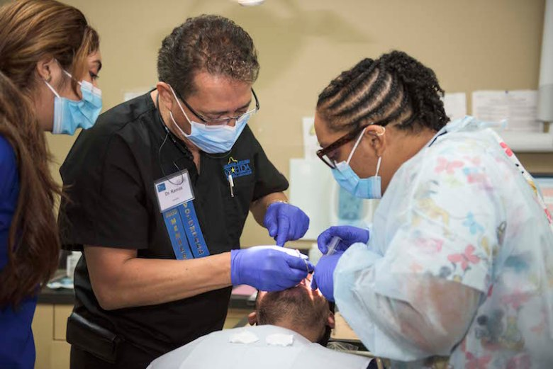 Volunteer dental staff working on a patient. Photo by Paola Longoria.