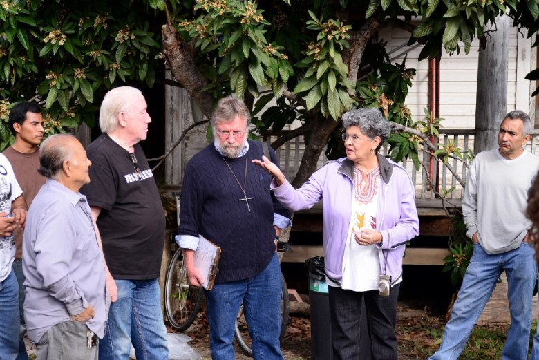 Miguel Calzada, Roger Gary, Pastor Tom Heger and Maria Berriozábal at the December 2014 cleanup party. File photo by Page Graham.